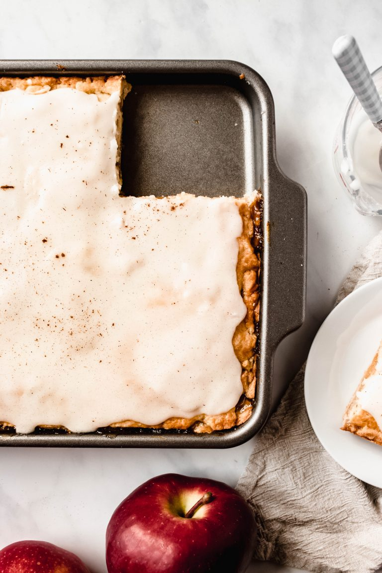 Best Apple Slab Pie With Icing   This Easy Apple Slab Pie is sweet, gooey and oh so cozy!   damnspicy.com