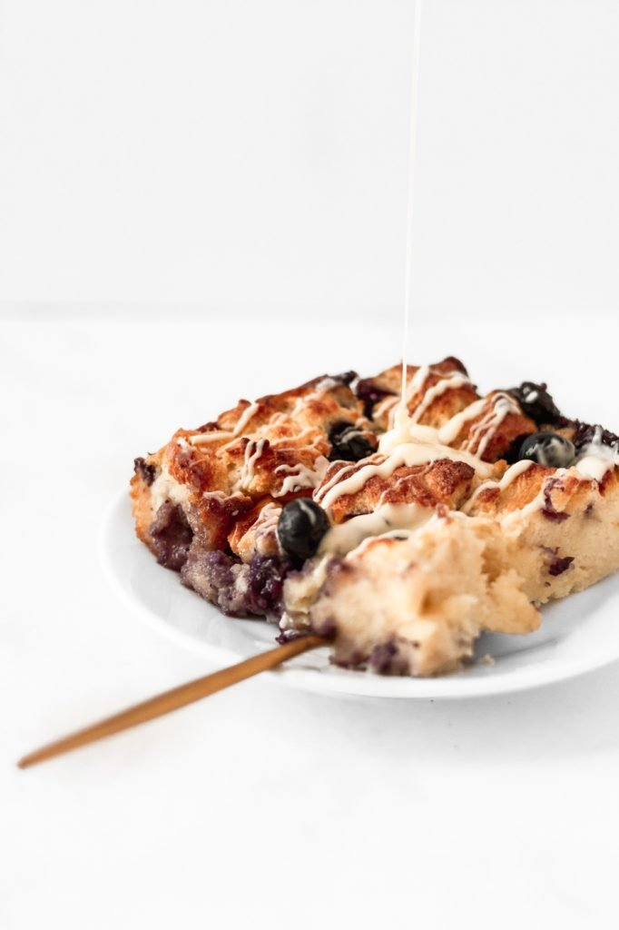 blueberry bread pudding with white chocolate sauce